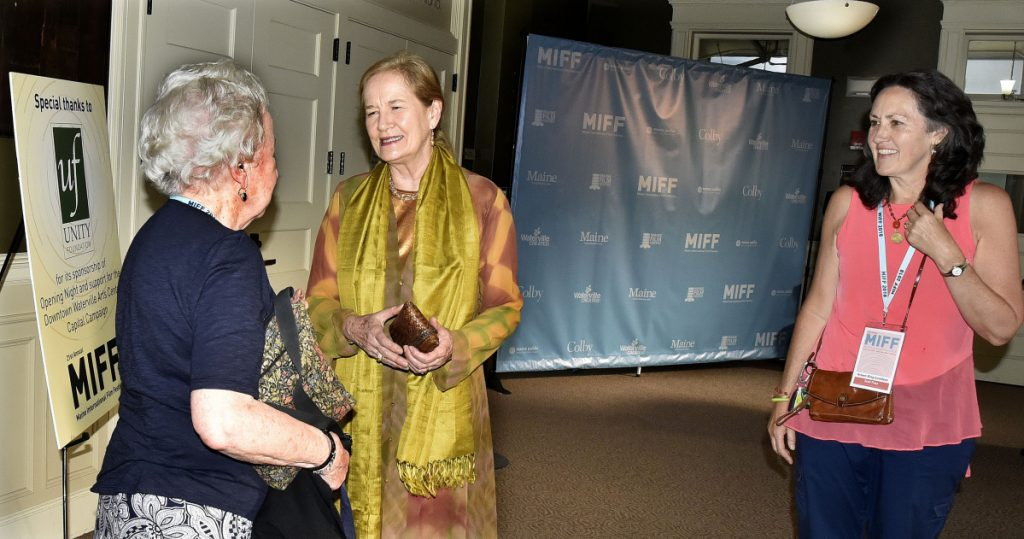 """Actress Dominique Sanda, center, chats with Jean Bird, left, of Waterville after arriving  at the Waterville Opera House where she was awarded the Maine International Film Festival Lifetime Achievement award after a viewing of her film """"The Garden of the Finzi-Continis"""" on Sunday. Accompanying Sanda at right is Arlene King-Lovelace of MIFF."""