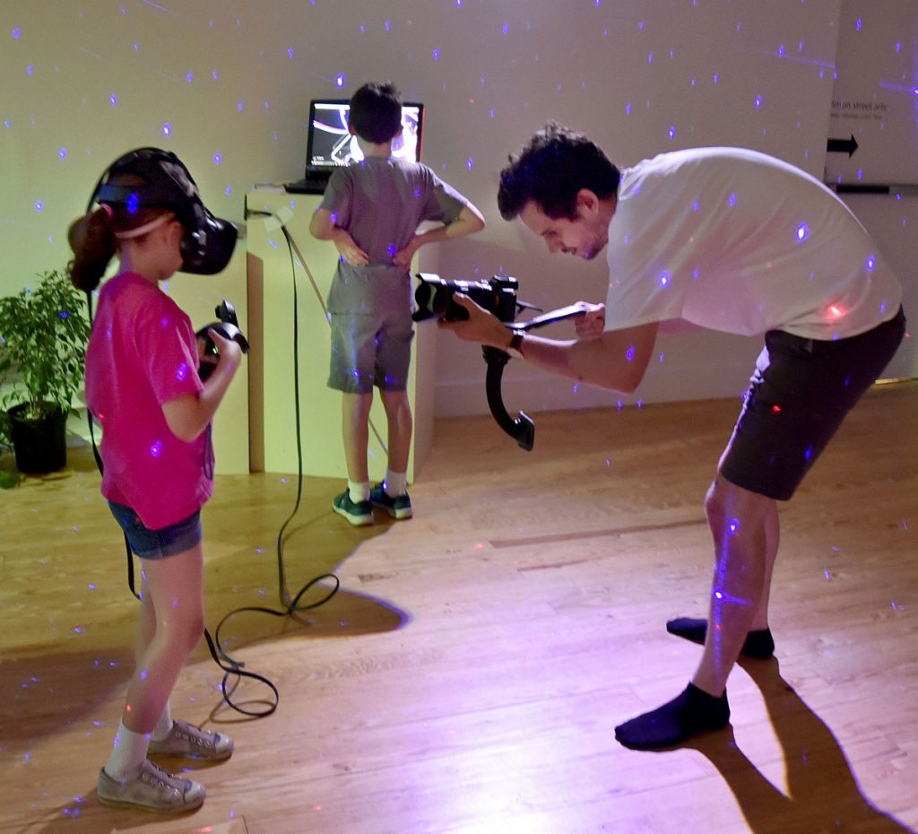 Penelope Graham uses a Tilt Brush virtual reality drawing device in a workshop on the art of digital creation, a MIFFONEDGE event at the Maine International Film Festival in Waterville on Monday. Wesley Steers films her.