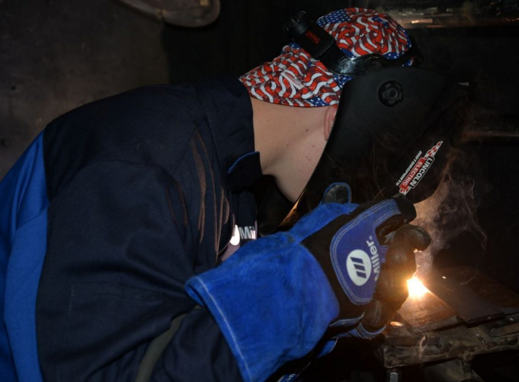 Bryson Dostie, a Lawrence High School student, works on his welding project at the Welding and Fabrication Day Camp at Kennebec Valley Community College.