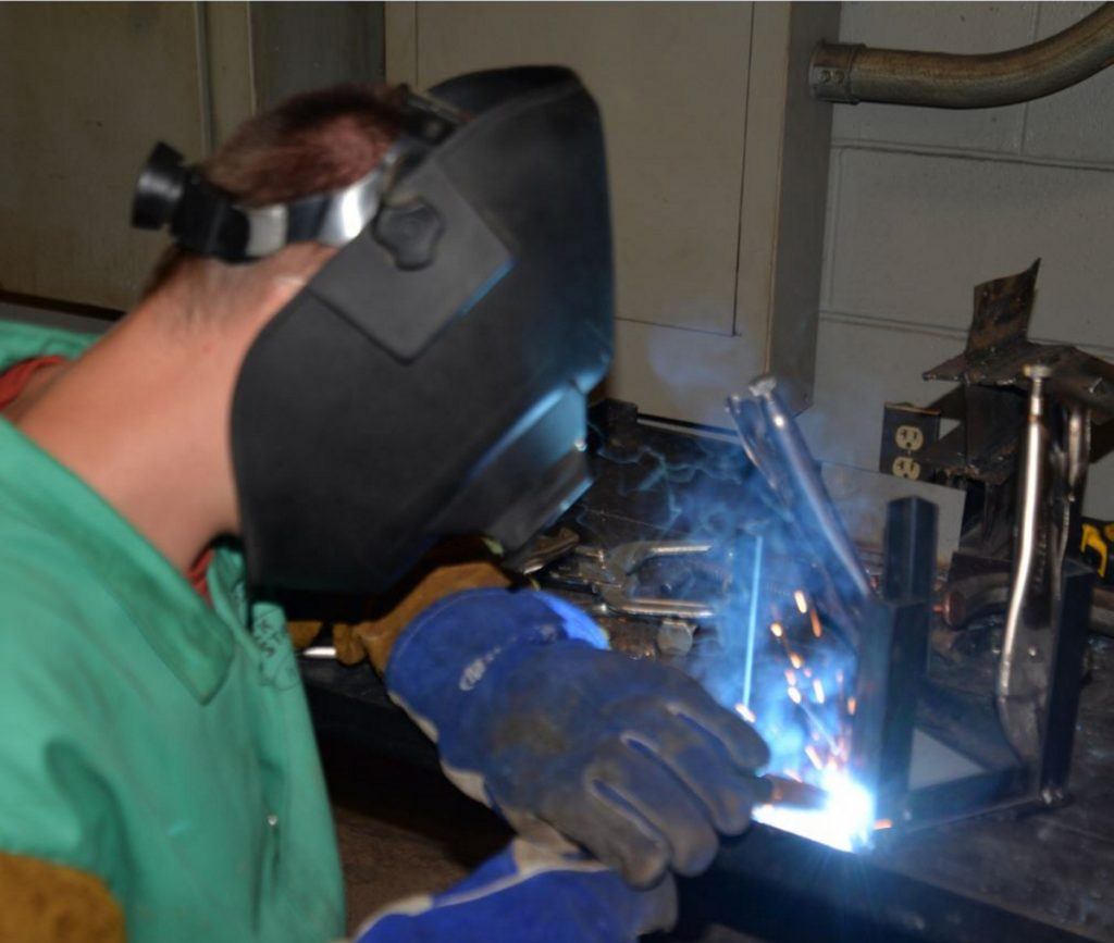 DJ Lorraine, a Messalonskee High School student, work on his welding project at the Welding and Fabrication Day Camp at Kennebec Valley Community College.