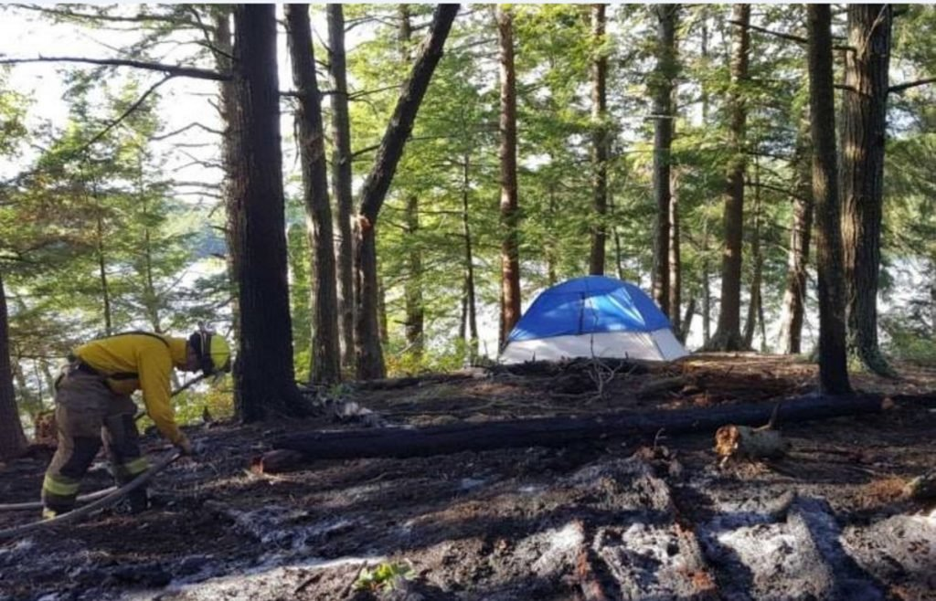 Members of the Belgrade Fire Department and the Maine Forest Service knocked down a fire Friday evening on an island in Hamilton Pond in Belgrade. Authorities say it resulted from a campfire.