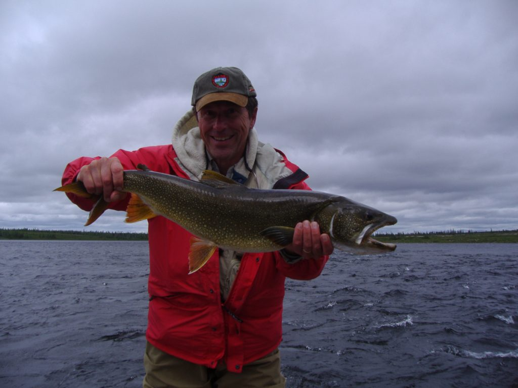 George Smith fishing for brook trout on Leaf River in northern Quebec.