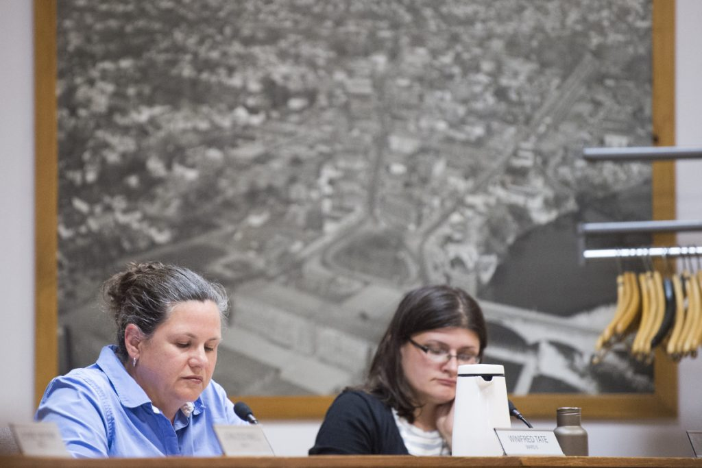Ward 6 Councilor Winnifred Tate, left, and Ward 7 Councilor Jackie Dupont listen Tuesday during a City Council meeting at The Center in Waterville.