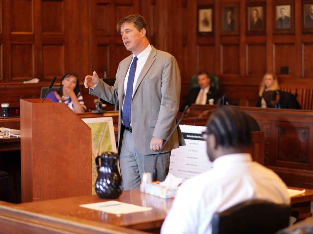 Jon Gale, attorney for David W. Marble Jr., addresses the jury during closing arguments Wednesday at the Cumberland County Courthouse in Portland. Marble, seen in the foreground, is on trial for two murder charges stemming from the Dec. 25, 2015, shooting deaths of Eric Williams and Bonnie Royer.