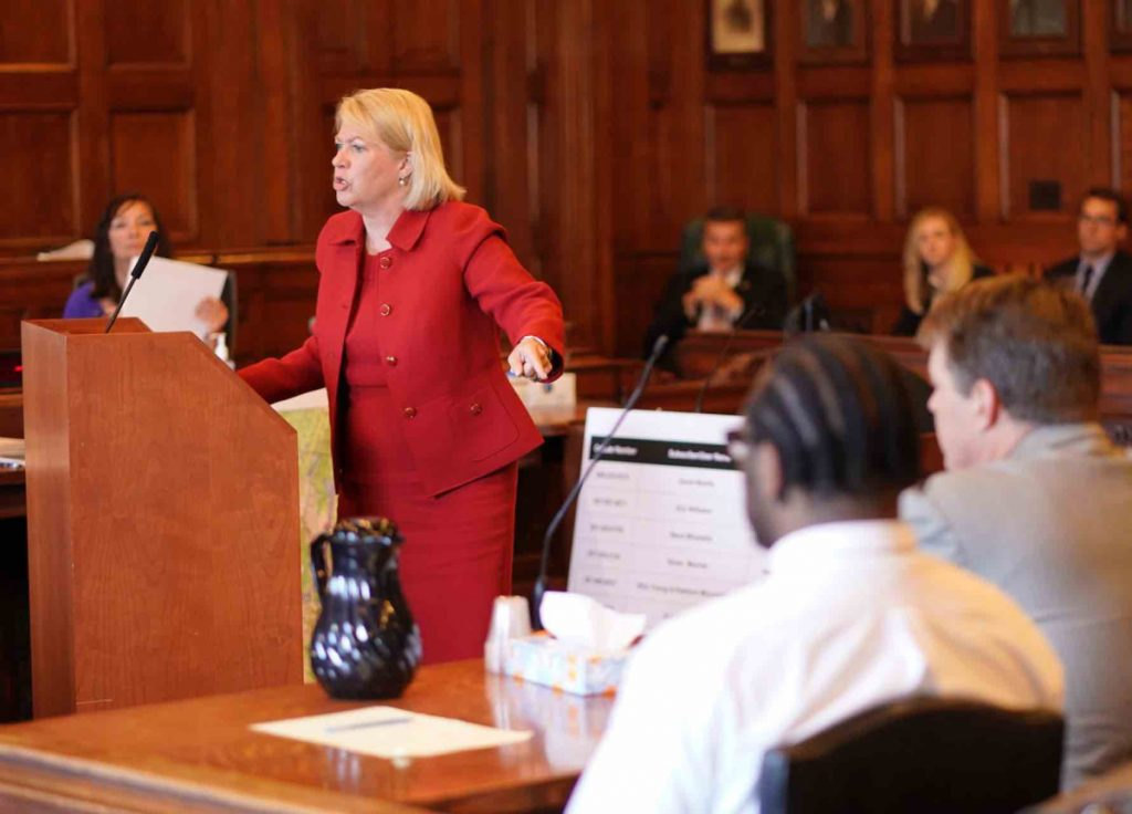 Lisa Marchese, deputy attorney general, addresses the jury during closing arguments Wednesday in the murder trial of David W. Marble Jr. at the Cumberland County Courthouse in Portland. Marble, seen in the foreground, is on trial for two murder charges stemming from the Dec. 25, 2015, shooting deaths of Eric Williams and Bonnie Royer.