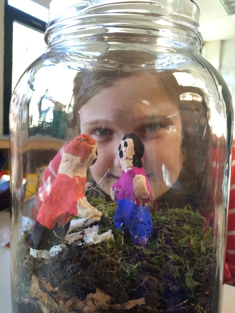Riley Hager gazes into a literrarium she created for author Jack Gantos' Joey Pigza Swallowed the Key.