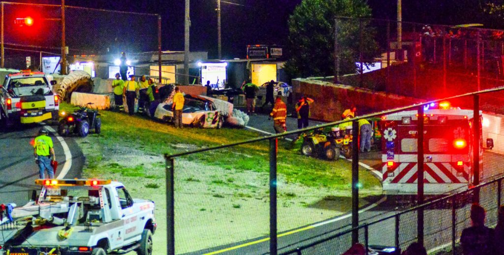 Emergency vehicles respond to a two-car crash involving Josh Bailey (2) and Mike Hodgkins, far right, in the Super Street feature on June 30 at Wiscasset Speedway.