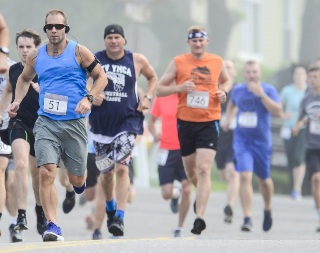 Runners head south on Middle Street at the foggy start of the Old Hallowell Day 5K race Saturday in Hallowell. There were 157 finishers in the early morning 3.1 mile road race that was followed up by a kids' fun runs in Vaughan Field.