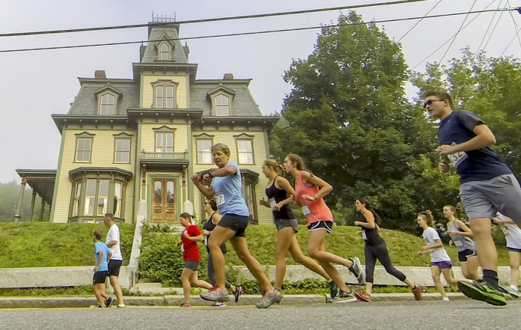 Runners head south past the Bodwell House at 15 Middle Street during the Old Hallowell Day 5K race on Saturday in Hallowell. The house was once owned by Gov. Joseph Robinson Bodwell.
