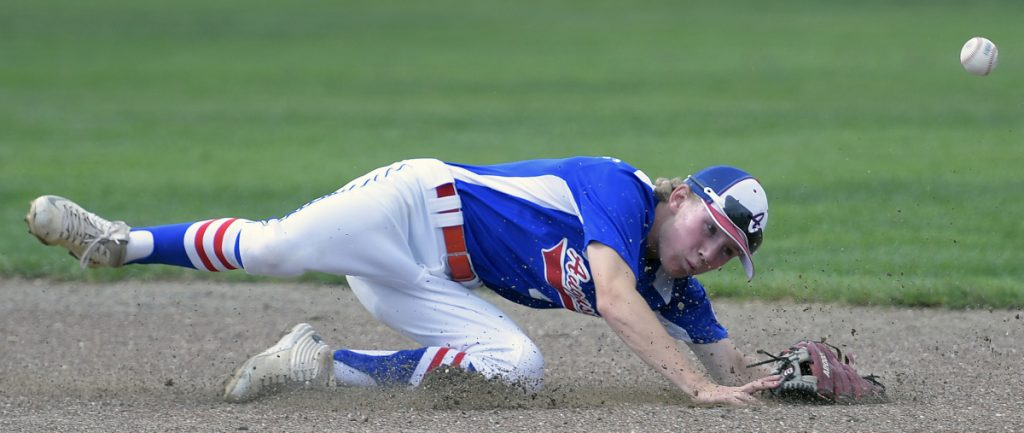 Augusta's Ian Stebbins can't stop the ball at second base against Tri-County during the 13-15 New England Regional Babe Ruth tournament Monday in Augusta.