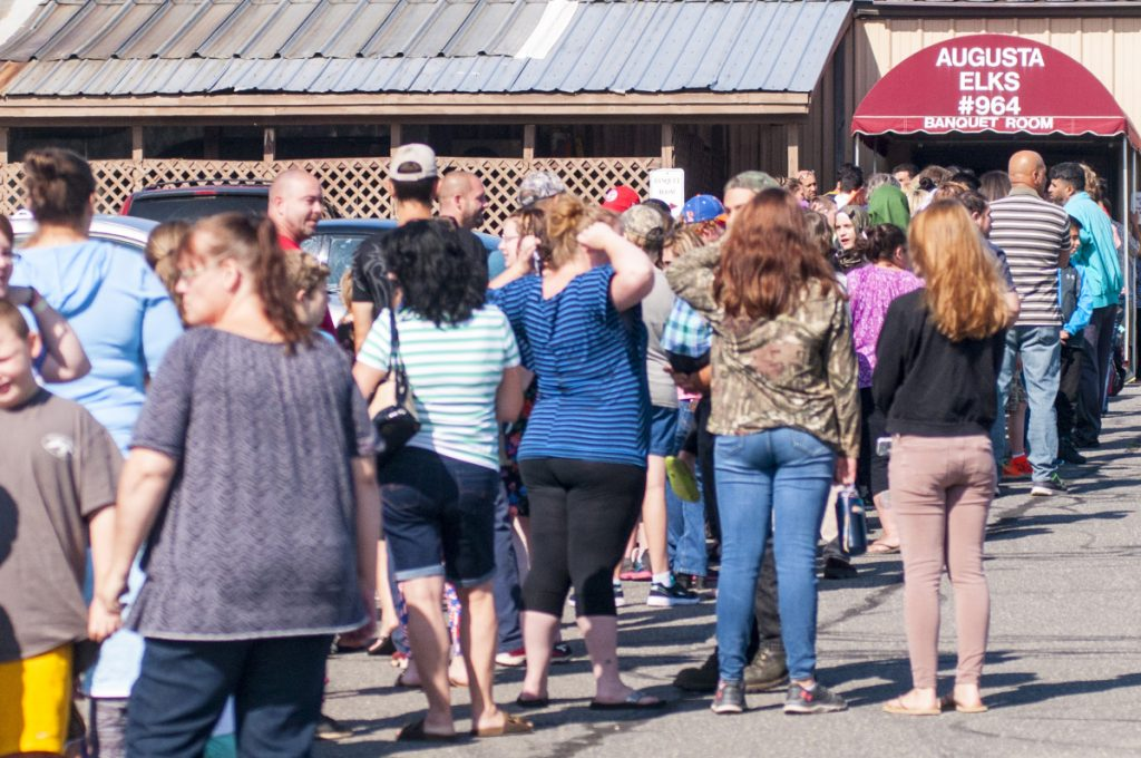 The line stretches across a parking lot Aug. 26, 2017, before the door opened at the backpack and school supplies giveaway at the Augusta Elks Lodge.