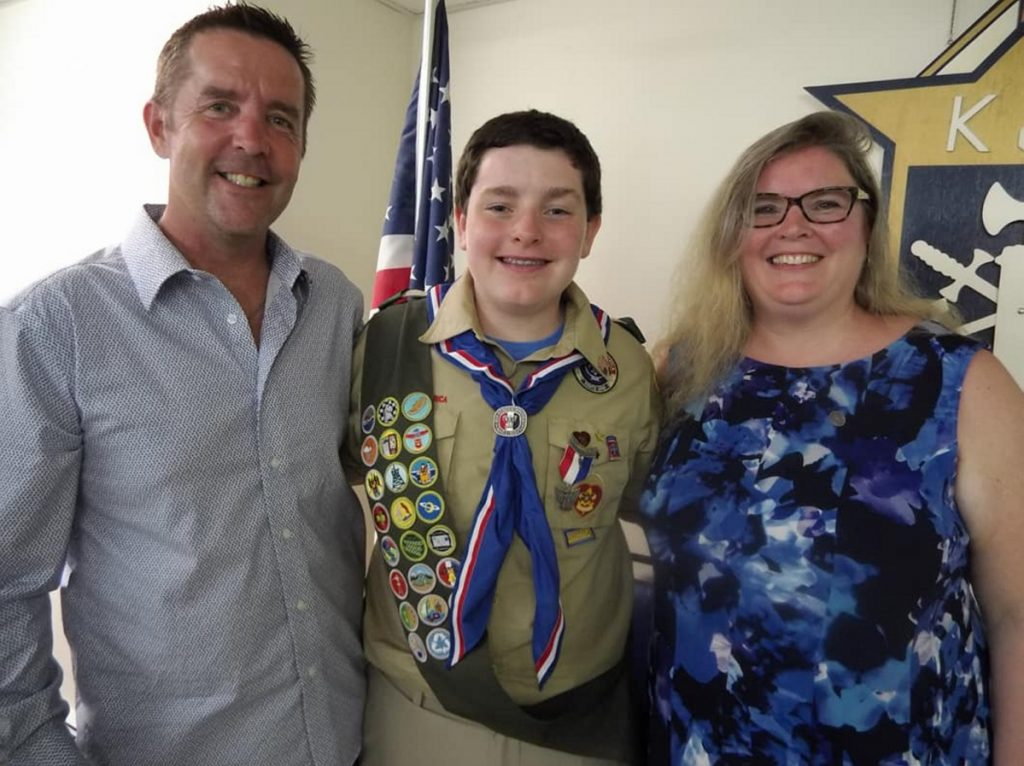 Eagle Scout Eric McDonnell, center, and his parents Patrick, left, and Audrey McDonnell of Augusta
