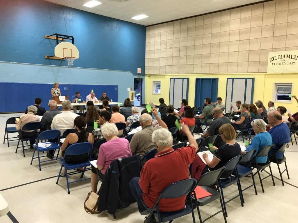 Residents vote on budget items Wednesday night at the Randolph Town Meeting.