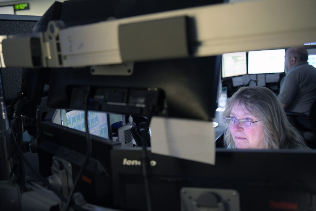 Department of Public Safety dispatchers communicate Thursday with firefighters, police and rescue workers at the Augusta agency. Only 14 dispatchers are handling emergency calls with a volume that previously has been handled by 35 dispatchers.