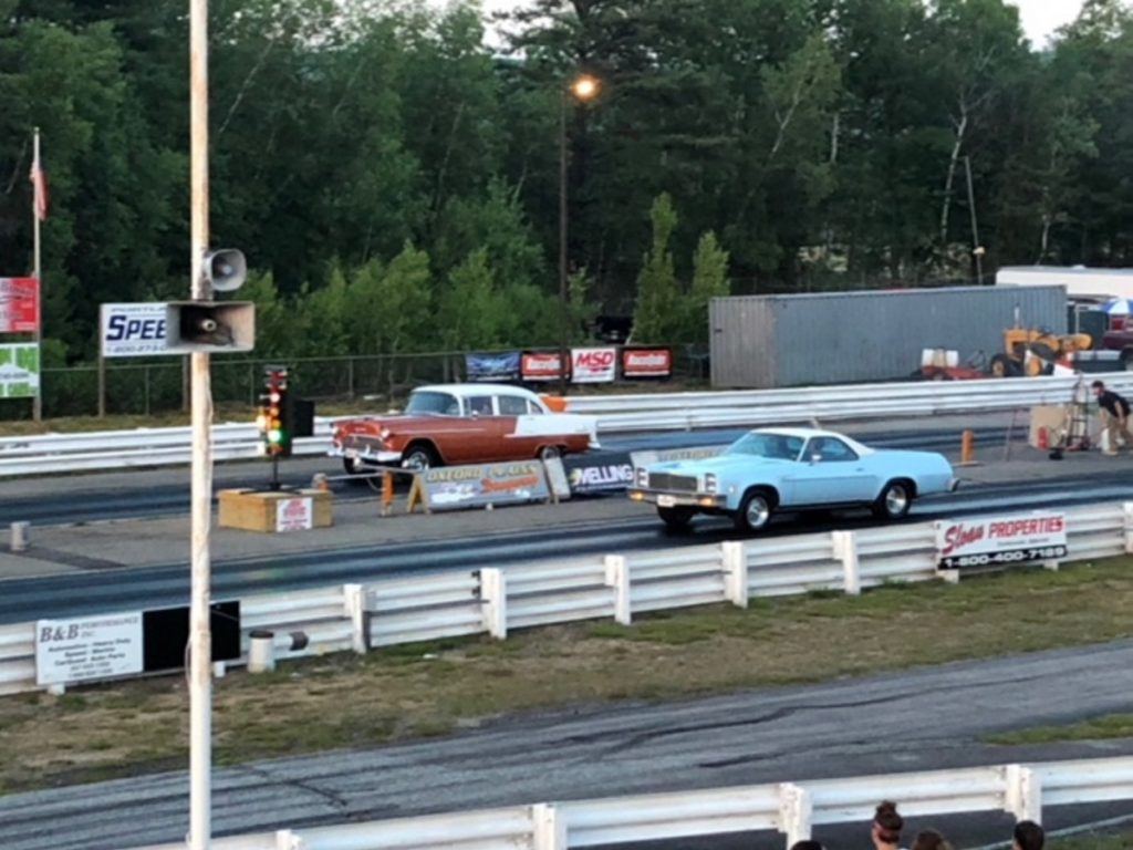 A pair of cars launch off the starting line at Oxford Plains Dragway on Route 26 in Oxford during a Friday night program at the track.