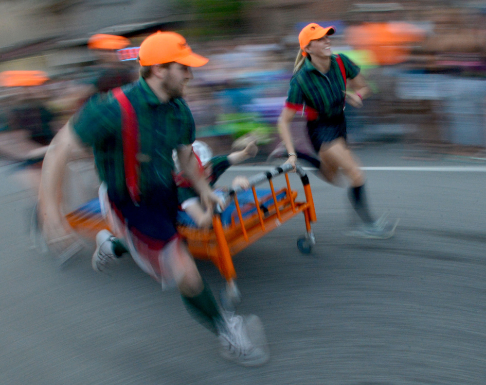 Team Skowhegan Savings Bank competes in the annual bed races in 2016 at Moonlight Madness as part of River Fest in downtown Skowhegan.