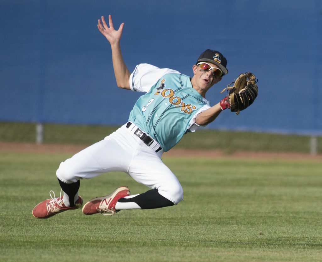 Messalonskee outfielder Jake Perry makes a sliding catch in the third inning of a Junior Legion state tournament game Monday against Fairfield at Mansfield Stadium in Bangor.