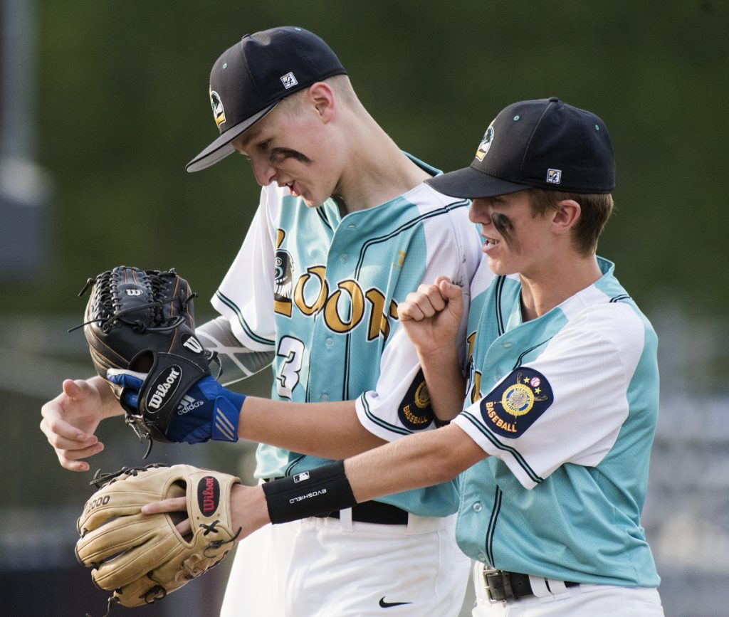 Messalonskee's Mason Violette, left, and Dylan Cunningham celebrate their 6-0 win over Fairfield in the Junior Legion state tournament Monday at Mansfield Stadium in Bangor.