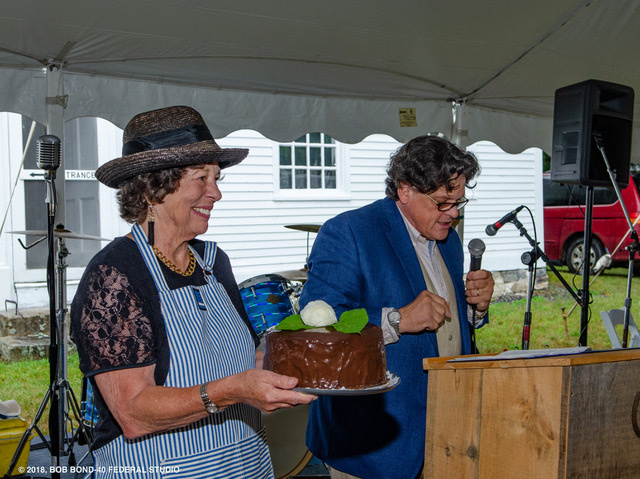 """Wendy Ross Eichler displays a """"Two in One Dessert,"""" that sold for a record-breaking $1,000 through the deft efforts of auctioneer Kaja Veilleux of Thomaston Place Auction Galleries."""