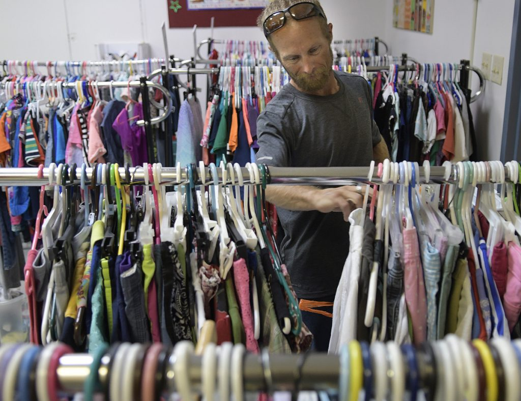 Joseph McKenna shops for clothing Thursday at Bridging the Gap, an Augusta nonprofit organization that oversees the Addie's Attic clothing bank, the Everyday Essentials toiletries pantry and, in the winter, the Augusta Community Warming Center.