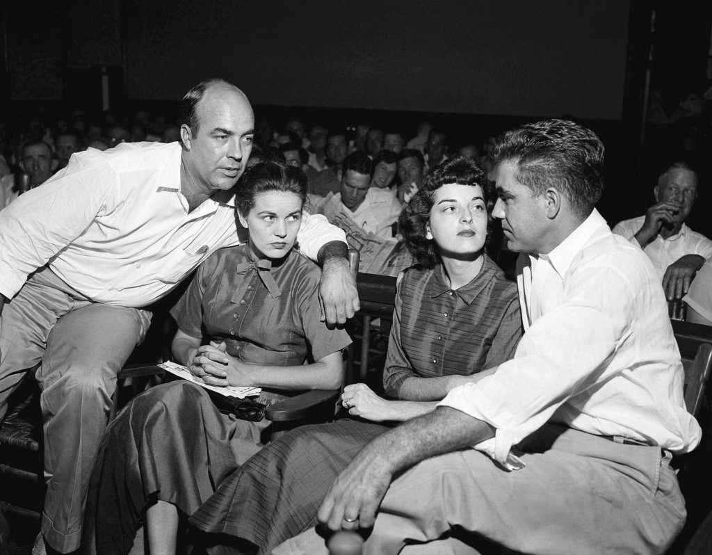 A Sept. 23, 1955, photo of, from left: J.W. Milam, his wife, Carolyn Bryant and Roy Bryant in a courtroom in Sumner, Mississippi. Bryant and his half-brother Milam were charged with murder but acquitted in the kidnap-torture slaying of 14-year-old Emmett Till.
