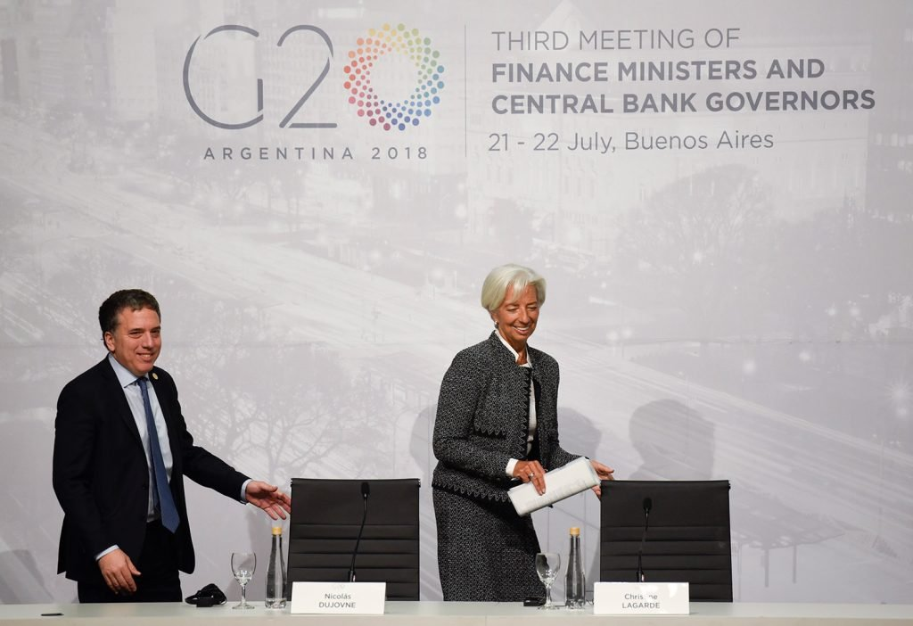 Christine Lagarde, International Monetary Fund managing director, and Argentina Treasury Minister Nicolas Dujovne arrive for a news conference during the G-20 meeting of finance ministers and Central Bank governors in Buenos Aires, Argentina, on Saturday.