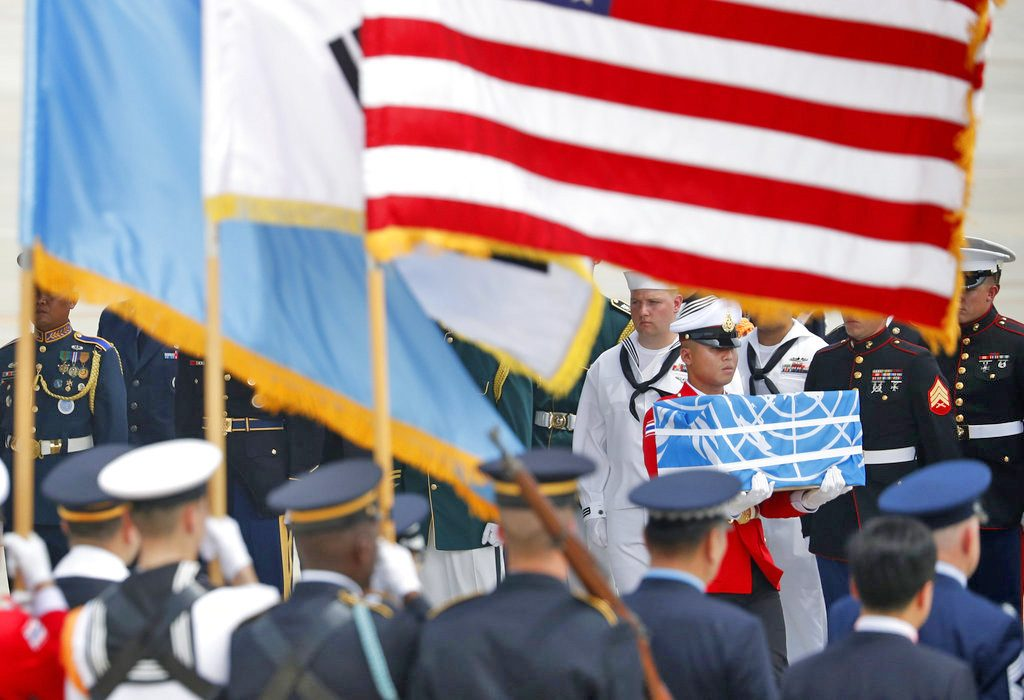 A member of a U.N. honor guard carries a casket containing the possible remains of an American soldier who was killed in the Korean War. The ceremony took place at Osan Air Base in Pyeongtaek, South Korea, Friday.