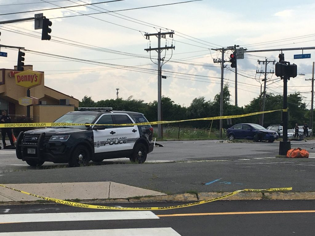 Portland Police investigate the scene of a 3-car crash where one person died at the junction of Riverside Street and Brighton Avenue on Saturday, July 28, 2018.