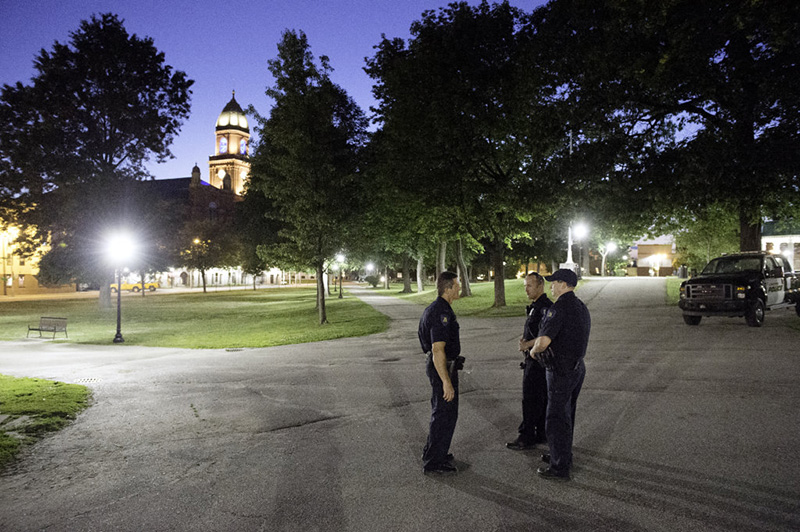 Lt. Mark Cornelio, left, officer Charlie Weaver and officer Jeremy Somma of the Lewiston Police Department keep an eye Wednesday night on Kennedy Park in downtown Lewiston.
