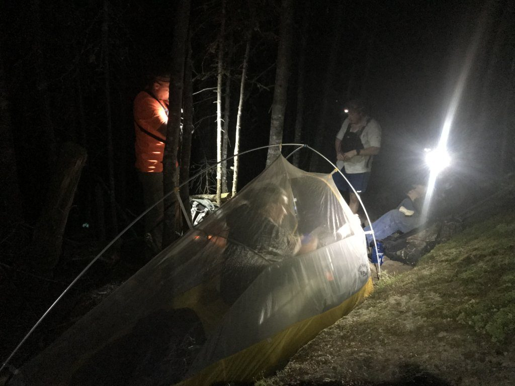 Emergency rescue responders set up shelter for Jennifer Custer, 38, of London, England early Friday after she broke her ankle on Bigelow Mountain in Wyman Township.