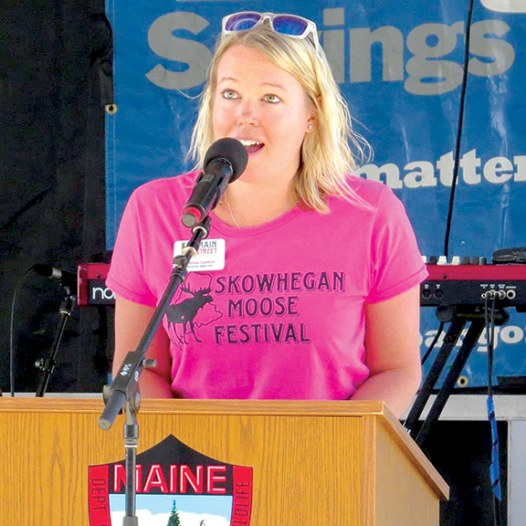 Kristina M. Cannon, executive director of Main Street Skowhegan, gives the welcome address at the Moose Festival in Skowhegan June 9, 2018. Contributed photo