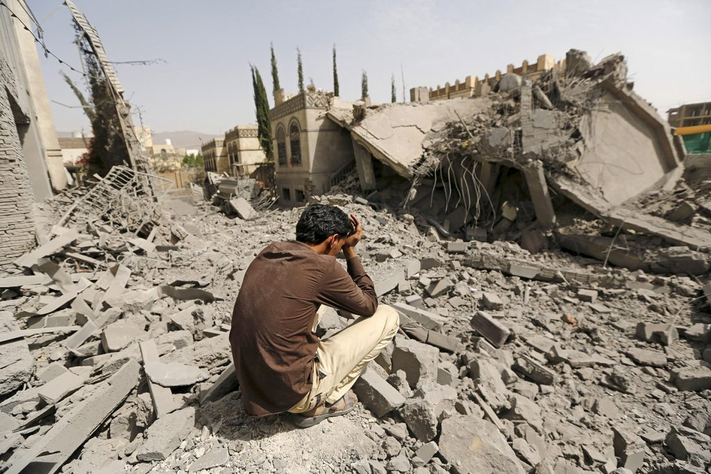 JUNE 15: A guard sits on the rubble of the house of Brigadier Fouad al-Emad, an army commander loyal to the Houthis, after air strikes destroyed it in Sanaa, Yemen. Warplanes from a Saudi-led coalition bombarded Sanaa overnight as the country's warring factions prepared for talks expected to start in Geneva.