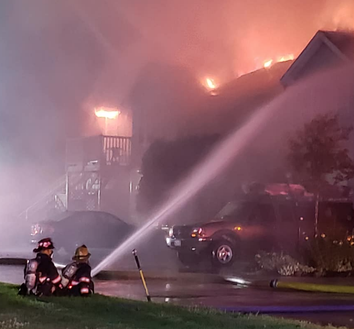 Firefighters battle a blaze engulfing an eight-unit condo building at 9 Cascade Road in Old Orchard Beach on Saturday night.