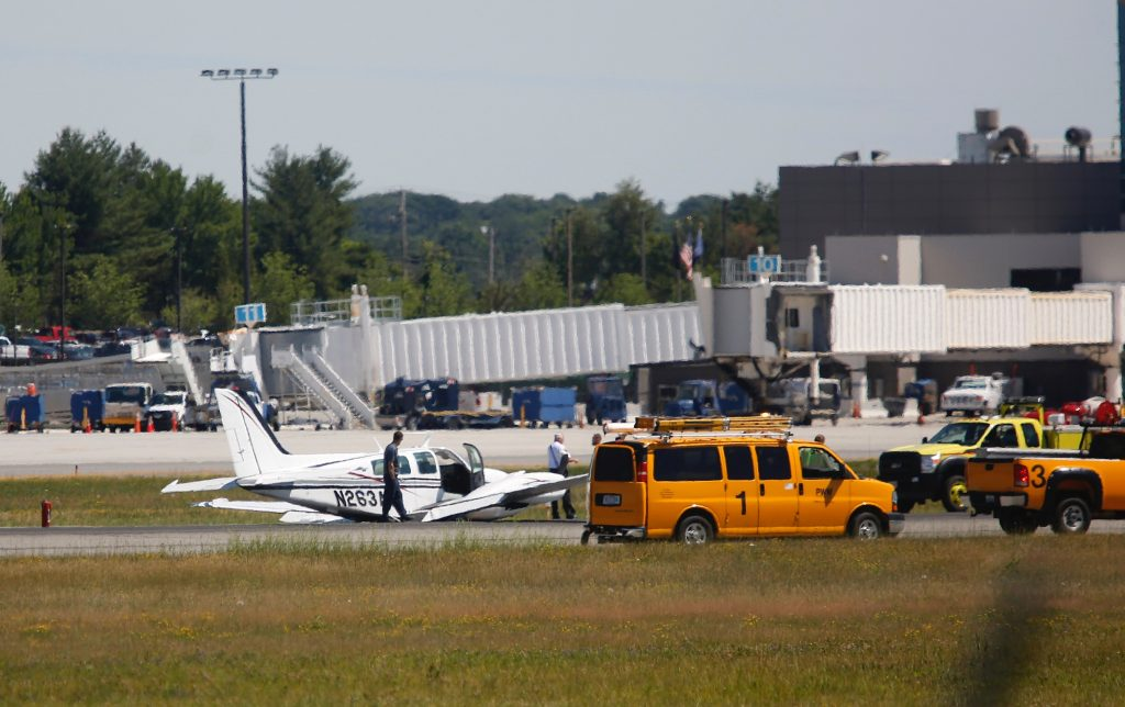 A twin-engine plane landed on its belly at Portland International Jetport on Thursday, causing all runways to close.