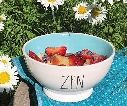 A selection of your favorite fresh, local fruits in season, some honey and a lime are all you need for a healthy, yummy dessert (or breakfast indulgence!) Served up in a pretty bowl, bites of seasonal fruit get a punch from a drizzle of tart/sweet dressing.  Nancy McGinnis photo
