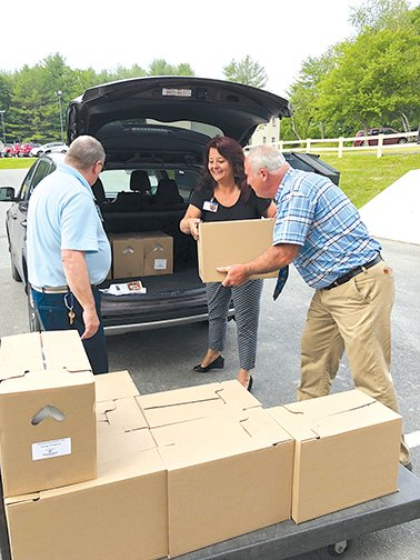 Volunteers unload Emergency Food Kits from Good Shepherd Food Bank for use at Inland Hospital physician practices. Contributed photo