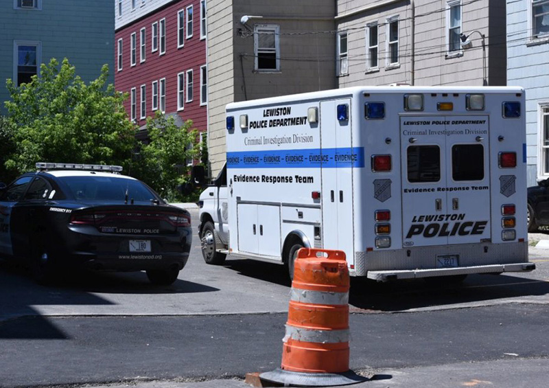 Police remain at the scene Saturday afternoon after an early morning shooting on Bartett Street in Lewiston.