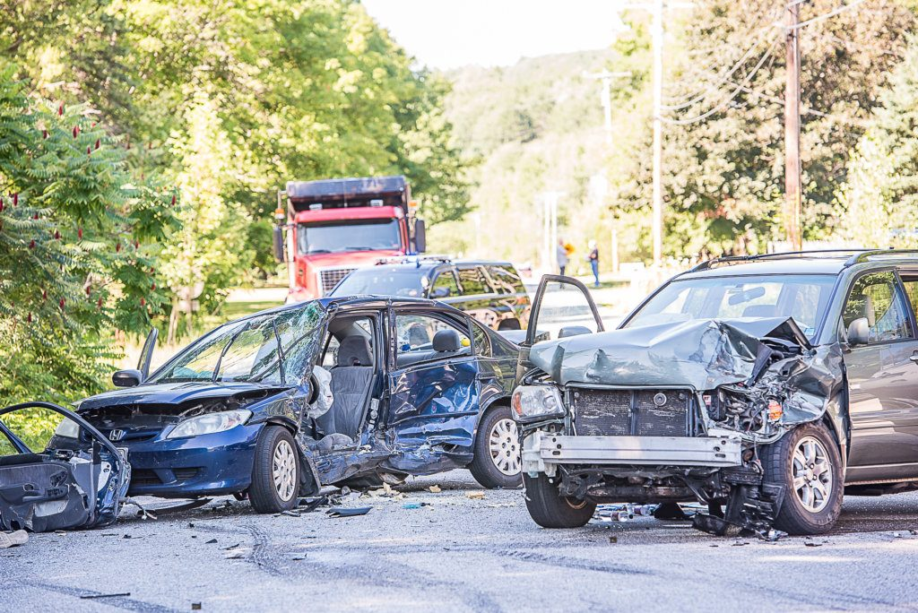 Police said Monday at least one person remains hospitalized after a two vehicle collision at the intersection of North Main and Bucknam streets in Mechanic Falls last Wednesday.