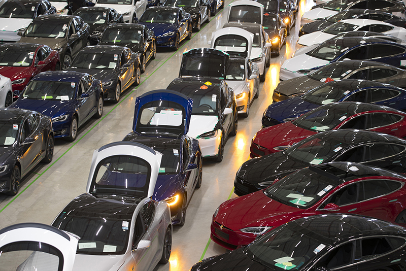 A line of new Tesla Model X sports utility vehicles, center, sit with Tesla Model S automobiles following assembly for the European market at the Tesla factory in Tilburg, Netherlands, on Dec. 9, 2016.