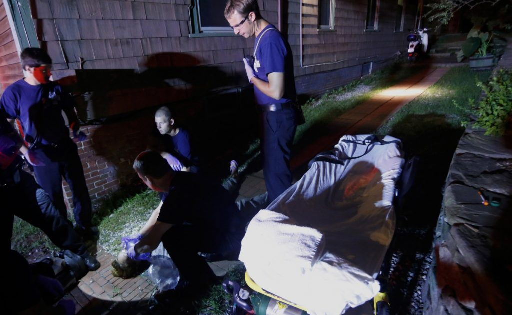 Portland paramedics respond to a 2015 overdose report before reviving an unconscious woman.