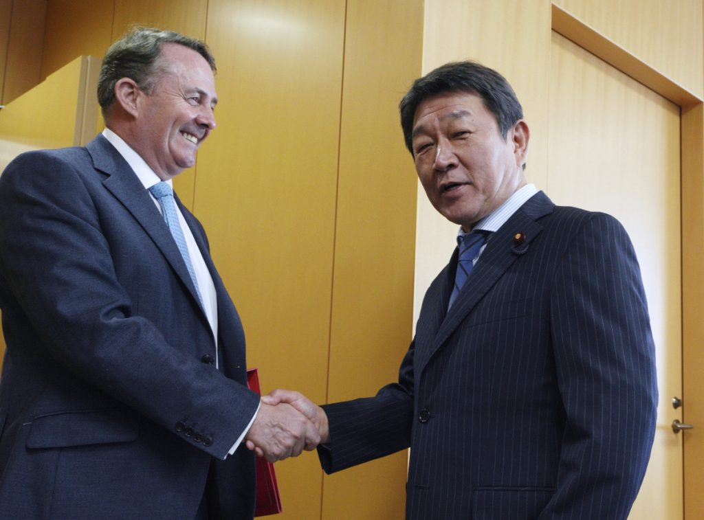 British trade representative Liam Fox, left, said Wednesday in Tokyo that he welcomed the support of Japanese minister Toshimitsu Motegi, right, for Britain's efforts to join an 11-country Pacific trade agreement.
