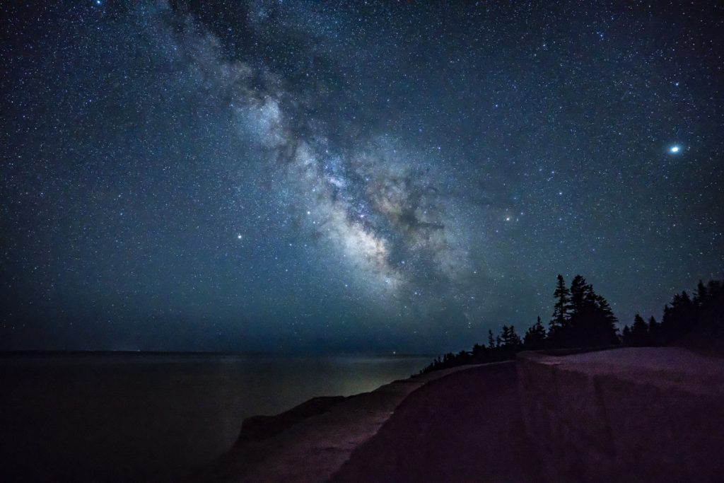 The Milky Way shines above the ocean off the coast of Acadia National Park in the early morning hours of April 23. Parks like Acadia and the Katahdin Woods and Waters National Monument are hoping to boost astrotourism by receiving a dark-sky designation from the International Dark-Sky Association.