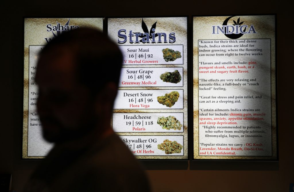 Screens display marijuana at a store in Las Vegas. Nevada regulators say the state's first year of adult-use pot sales has exceeded expectations.