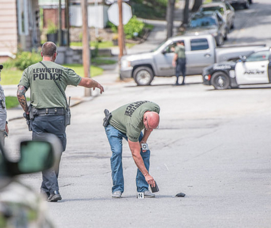 Lewiston police pick up evidence on Bradley Street after a shooting was reported Thursday afternoon. Statistically, crime is down in Lewiston. But tension and unease are high after a pair of recent homicides.
