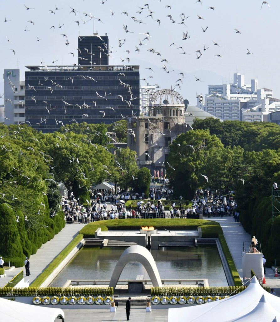 Doves fly over the cenotaph dedicated to the victims during a ceremony to mark the 73rd anniversary of the atomic bombing at Hiroshima Peace Memorial Park in Hiroshima.