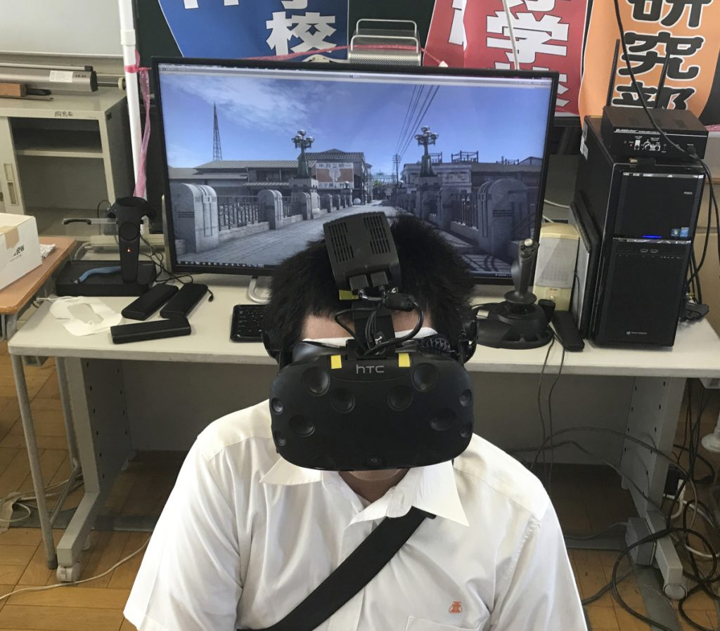 Namio Matsura of the computation skill research club views Hiroshima before the bomb fell in virtual reality.