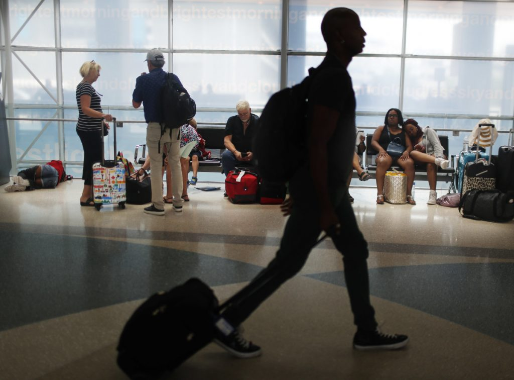 Travelers gather on benches to wait for flights as others make their way to their gate at the Fort Lauderdale-Hollywood International Airport in Florida. Consumer advocates see potential victories and setbacks in two bills before Congress.