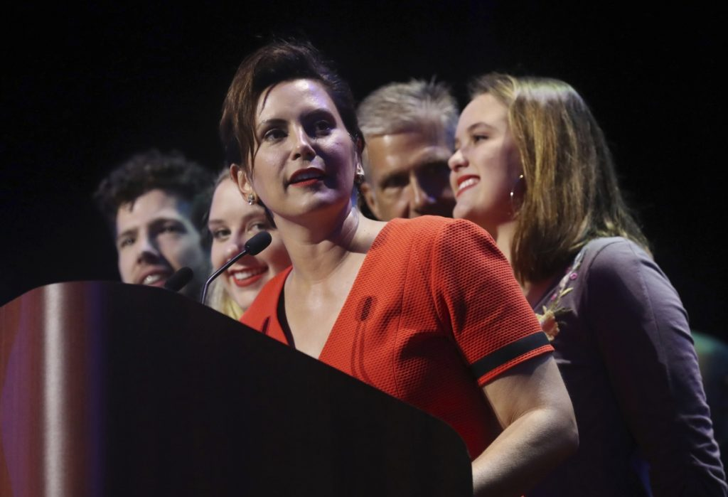 Michigan Democratic gubernatorial candidate Gretchen Whitmer stands with her family and addresses her supporters after winning the primary late Tuesday night in Detroit. Whitmer will face Republican Bill Schuette in November.