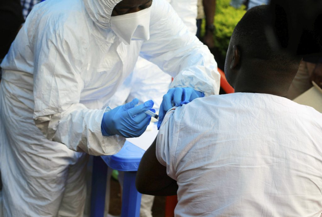 A healthcare worker from the World Health Organization gives an Ebola vaccination to a front line aid worker in Mangina, Democratic Republic of Congo on Wednesday.