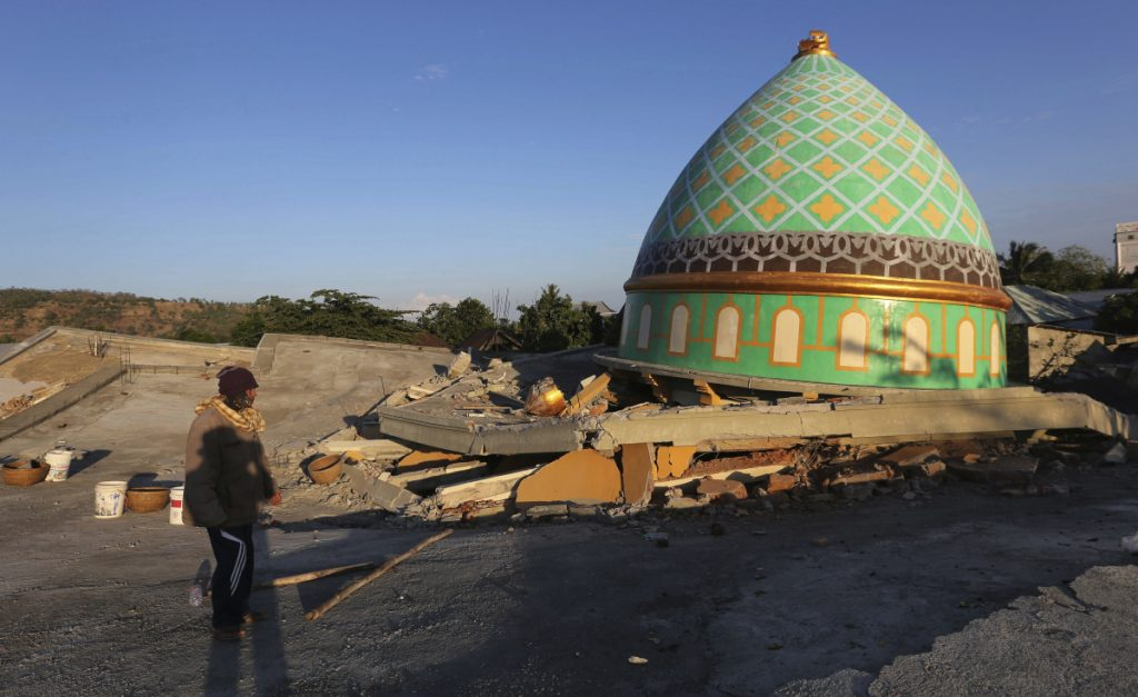 Locals view the collapsed Jamiul Jamaah Mosque in Bangsal, North Lombok, Indonesia, on Wednesday. The area was devastated by the powerful quake that struck Sunday night, causing widespread fatalities and property damage.